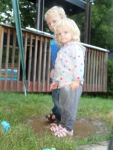 Liam in Ava in their mud puddle
